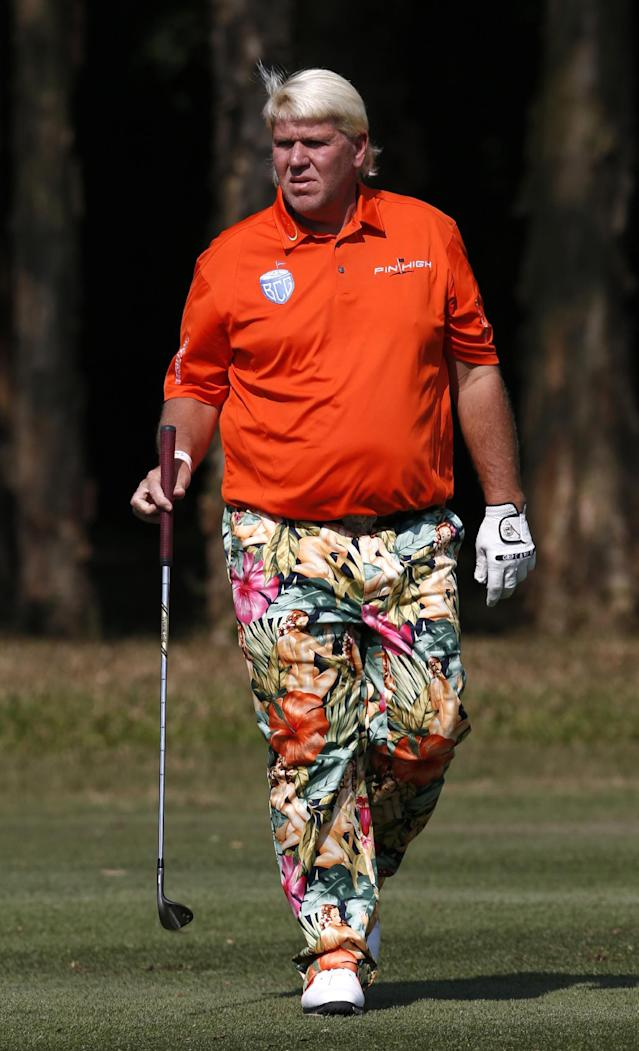 John Daly of the U.S. reacts after hitting a ball on the 10th hole during the day one match of the 2013 Hong Kong Open golf tournament in Hong Kong Thursday, Dec. 5, 2013. (AP Photo/Kin Cheung)