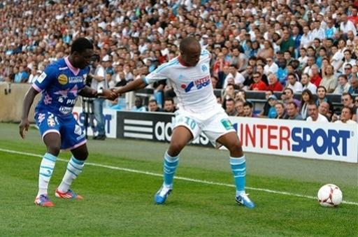 Marseille's Ghanaian forward Andre Ayew, right, challenges Evian's defender Brice Djadjedje of Ivory Coast for the ball during their League One soccer match at the Velodrome stadium, in Marseille, southern France, Sunday, Sept. 23, 2012. (AP Photo/Claude Paris)