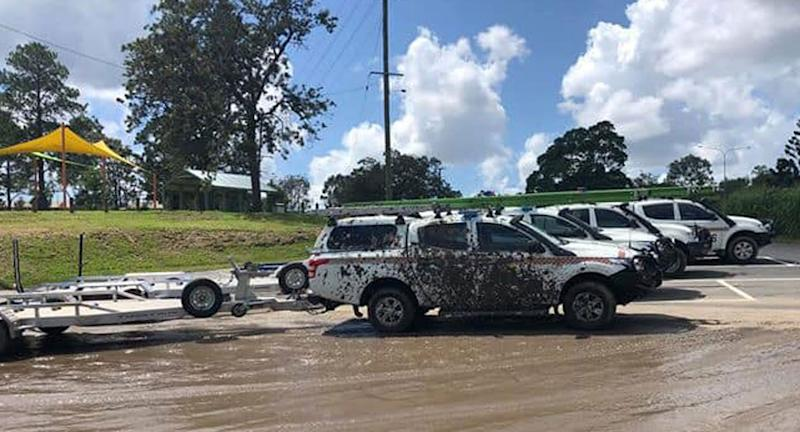 A Logan City SES vehicle parked at Loganlea Boat Ramp covered in mud.
