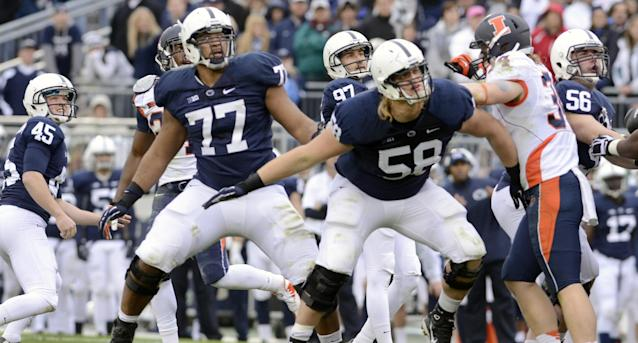 Penn State holder Alex Butterworth (45), kicker Sam Ficken (97), offensive tackle Garry Gilliam (77), tackle Adam Gress (58) and guard Anthony Alosi (56) watch Ficken's field goal tie the game and force overtime against Illinois during the second half an NCAA college football game in State College, Pa., Saturday, Nov. 2, 2013. Penn State defeated Illinois 24-17 in overtime. (AP Photo/John Beale)