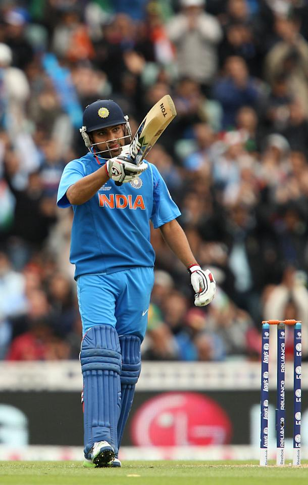 India's Rohit Sharma celebrates reaching fifty runs during the ICC Champions Trophy match at the Kia Oval, London.