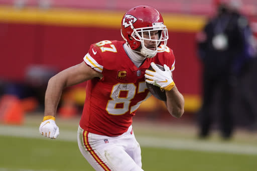 Kansas City Chiefs tight end Travis Kelce runs up field after catching a pass during the second half of an NFL divisional round football game against the Cleveland Browns, Sunday, Jan. 17, 2021, in Kansas City. (AP Photo/Charlie Riedel)
