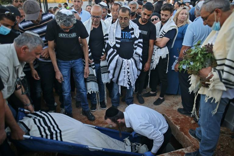 Israeli mourners attend the funeral of Yigal Yehoshua in the city of Modiin on May 18 (AFP/ahmad gharabli)