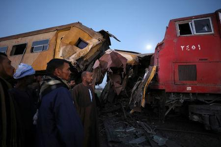 Rescue workers look at the wreckage after a train crash in Kom Hamada in the northern province of Beheira, Egypt, February 28, 2018. REUTERS/Mohamed Abd El Ghany