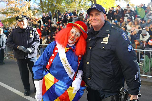 <p>A clown from the Parade Brigade poses for a photo with one of New York's Finest during the 91st Macy's Thanksgiving Day Parade in New York, Nov. 23, 2017. (Photo: Gordon Donovan/Yahoo News) </p>