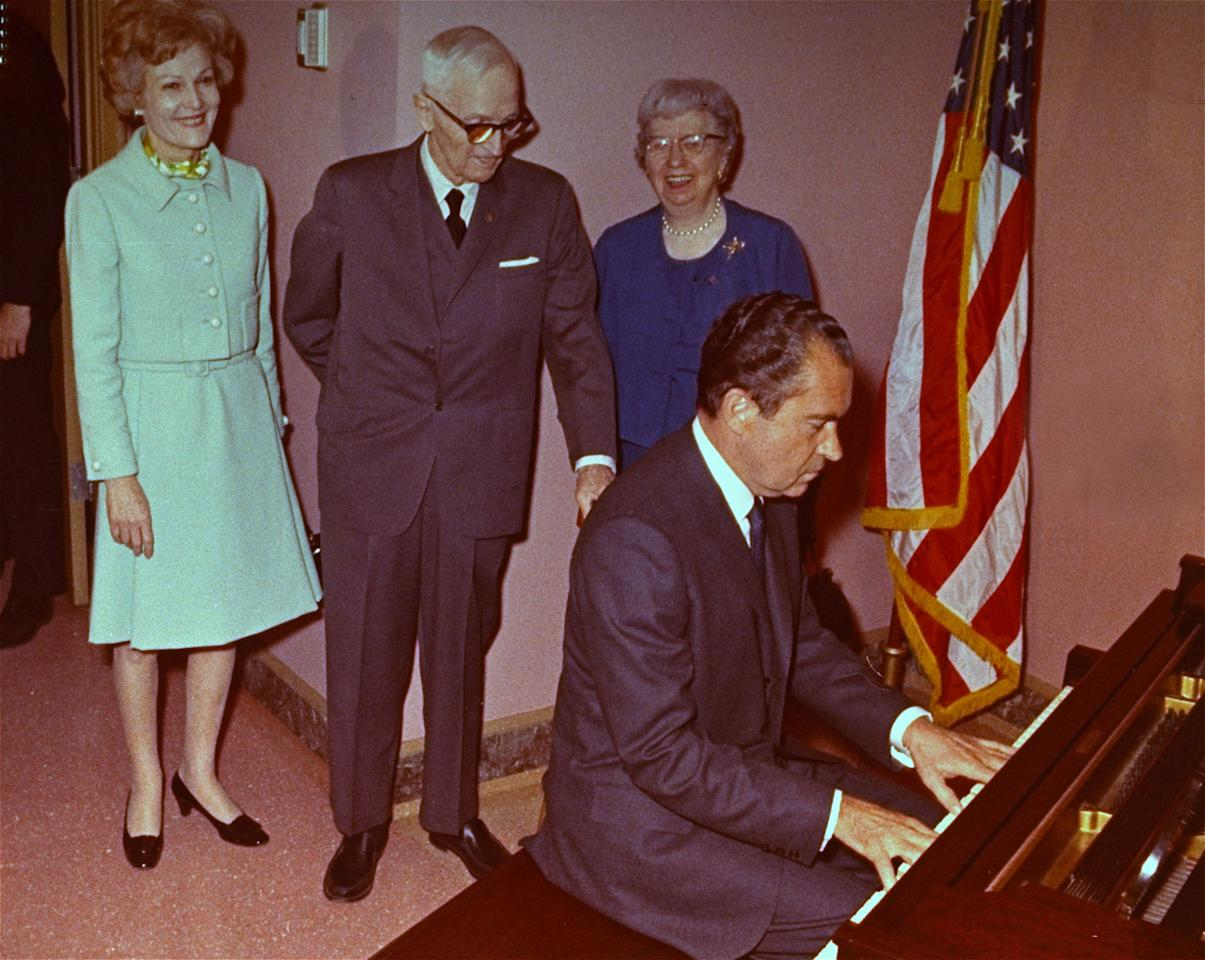 FILE - In this March 21, 1969 file photo, President Richard Nixon plays the piano as first lady Pat Nixon, former President Harry Truman and his wife Bess watch at the Truman Library in Independence, Mo. This is the piano Truman used to play in the White House and was presented to him as a gift by Nixon. Through the years, commanders-in-chief have turned musicians-in-chief, with varying results. (AP Photo)
