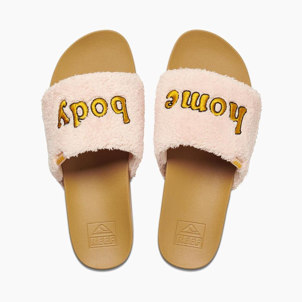 """<p>Keep your tootsies warm, stylish, <em>and</em> sassy in these <a href=""""https://www.reef.com/cushion-scout-mantra/ML05088.html?dwvar_ML05088_color=HOME%20BODY&cgid=root#q=off%2Bduty&lang=default&cgid=root&start=1"""" rel=""""nofollow noopener"""" target=""""_blank"""" data-ylk=""""slk:uber comfy slippers"""" class=""""link rapid-noclick-resp"""">uber comfy slippers</a>. They're perfect for Zoom meetings, virtual dinner dates, and everything in between.</p> <p><strong>$50, <a href=""""https://www.reef.com/cushion-scout-mantra/ML05088.html?dwvar_ML05088_color=HOME%20BODY&cgid=root#q=off%2Bduty&lang=default&cgid=root&start=1"""" rel=""""nofollow noopener"""" target=""""_blank"""" data-ylk=""""slk:reef.com"""" class=""""link rapid-noclick-resp"""">reef.com</a></strong></p>"""