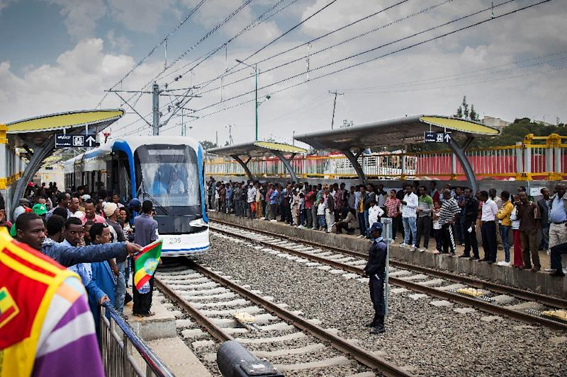 Passengers queue to ride Ethiopia's new tramway on September 20, 2015 in Addis Abada (AFP Photo/Mulugeta Ayene)