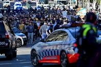 Police block the way to marching protesters in Sydney
