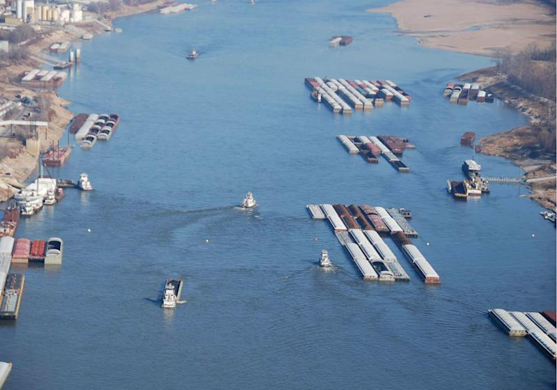 This Nov. 28, 2012 photo provided by The United States Coast Guard shows vessels navigating through close quarters at a fleeting area, where barges are picked up and dropped off, on the Mississippi River near St. Louis. Mo. The Mississippi, after months of drought, is approaching the point where it may become to shallow for barges that navigate the river. (AP Photo/United States Coast Guard, Colby Buchanan)