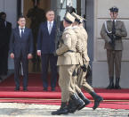 Poland's President Andrzej Duda,center, welcomes Ukraine's President Volodymyr Zelenskiy,left, before talks on bilateral relations and Ukraine's ties with Europe under the new government, in front of the Presidential Place in Warsaw, Poland, Saturday, Aug. 31, 2019. Zelenskiy is in Warsaw with members of his new Cabinet and will attend ceremonies marking 80 years of the start of World War II on Sunday.(AP Photo/Czarek Sokolowski)