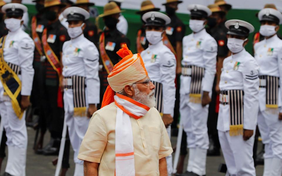Indian Prime Minister Narendra Modi inspects the honour guard during Independence Day celebrations at the historic Red Fort in Delhi - REUTERS/Adnan Abidi