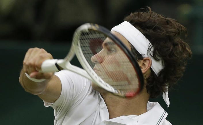 Roger Federer of Switzerland plays a shot to Andy Murray of Britain during the men's singles final match at the All England Lawn Tennis Championships at Wimbledon, England, Sunday, July 8, 2012. (AP Photo/Anja Niedringhaus)
