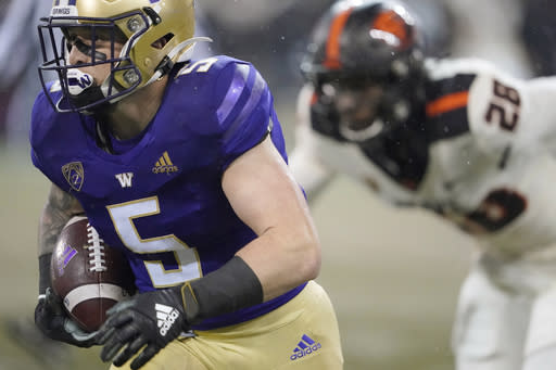 Washington running back Sean McGrew (5) runs for a touchdown against Oregon State during the first half of an NCAA college football game, Saturday, Nov. 14, 2020, in Seattle. (AP Photo/Ted S. Warren)