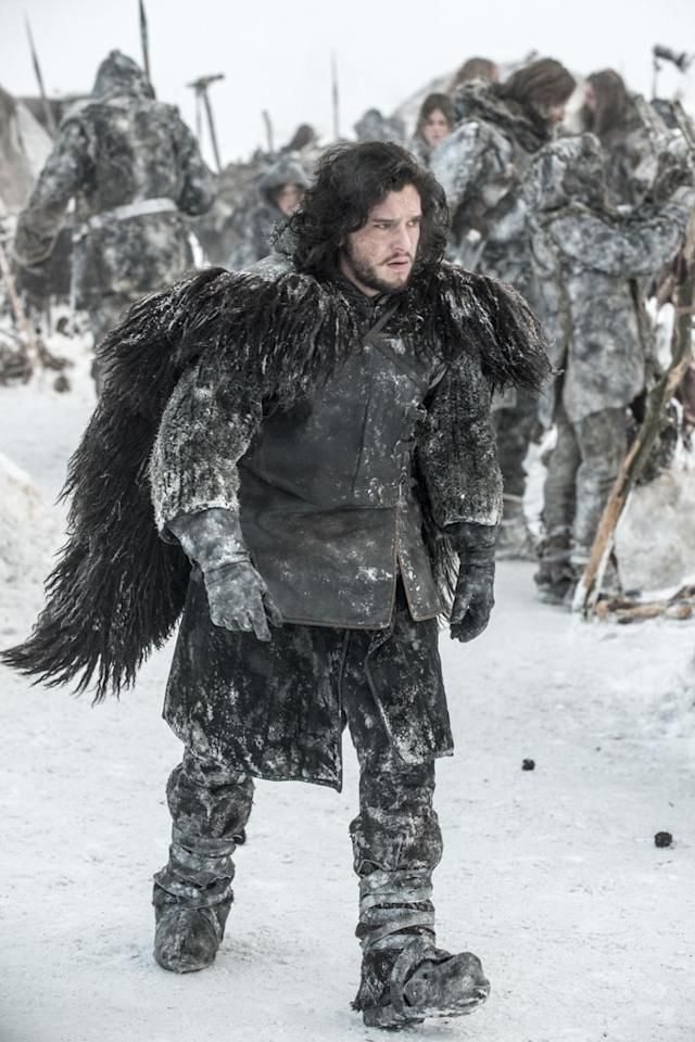 """Jon Snow (Kit Harrington) strides through ice and snow. In Season 3, he's set to meet the """"King Beyond the Wall,"""" Mance Raydar (new cast member Ciaran Hinds)."""