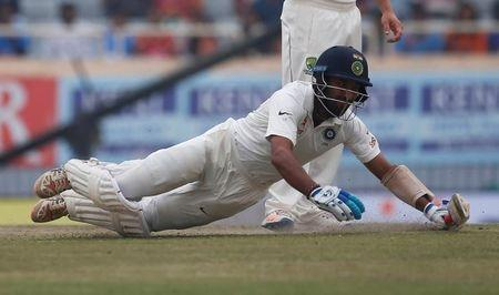 Cricket - India v Australia - Third Test cricket match - Jharkhand State Cricket Association Stadium, Ranchi, India - 19/03/17 - India's Cheteshwar Pujara dives to avoid being run out.  REUTERS/Adnan Abidi