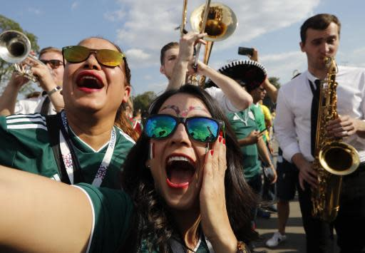 Mexico soccer fans join in with a Russian jazz band ahead of the group F match between Germany and Mexico at the 2018 soccer World Cup in the Luzhniki Stadium in Moscow, Russia, Sunday, June 17, 2018. (AP Photo/Alexander Zemlianichenko)