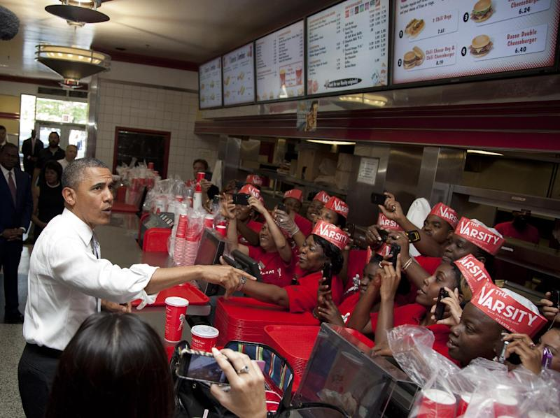 President Barack Obama places an order at The Varsity restaurant, Tuesday, June 26, 2012, in Atlanta. (AP Photo/Carolyn Kaster)
