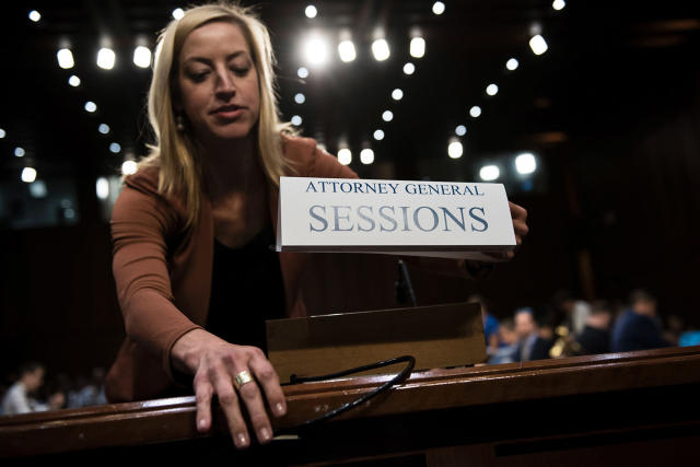 <p>A Senate staff member places a name card for US Attorney General Jeff Sessions before a hearing of the Senate Select Intelligence Committee on Capitol Hill June 13, 2017 in Washington, D.C. (Photo: Brendan Smialowski/AFP/Getty Images) </p>