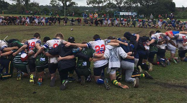 Warringah and Eastwood players observe a moment's silenceduring the under-17 championships. Source: Facebook