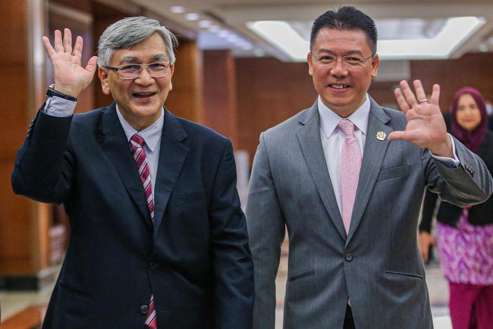 Former Dewan Rakyat Speaker Tan Sri Mohamad Ariff Md Yusof and Deputy Speaker Nga Kor Ming wave at reporters at Parliament July 13, 2020. — Picture by Hari Anggara