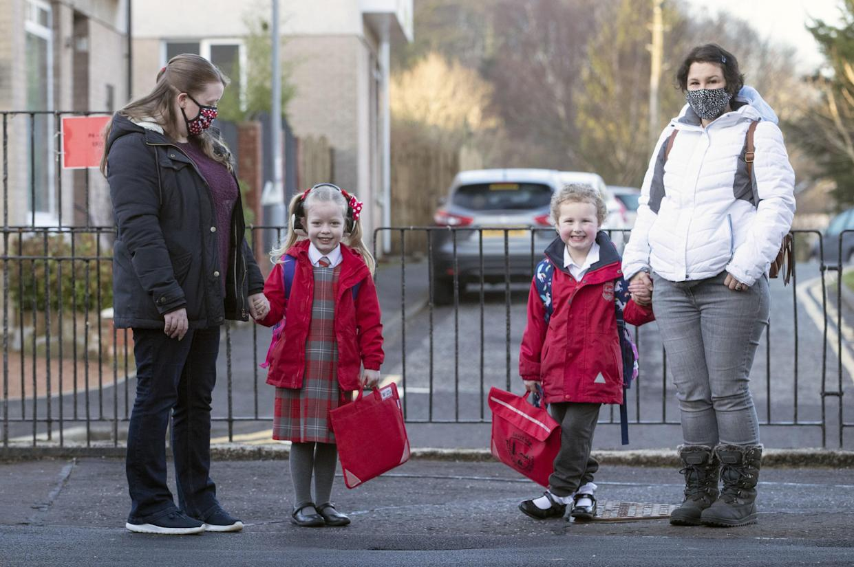 Parents have been urged not to socialise at the school gate as some youngsters in Scotland returned to class (Jane Barlow/PA)