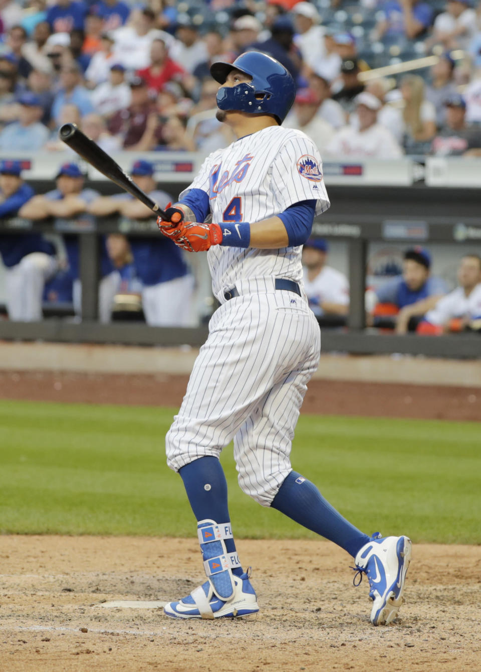 New York Mets' Wilmer Flores (4) follows through on a home run during the tenth inning in the first game of a baseball doubleheader against the Philadelphia Phillies Monday, July 9, 2018, in New York. The Mets won 4-3. (AP Photo/Frank Franklin II)
