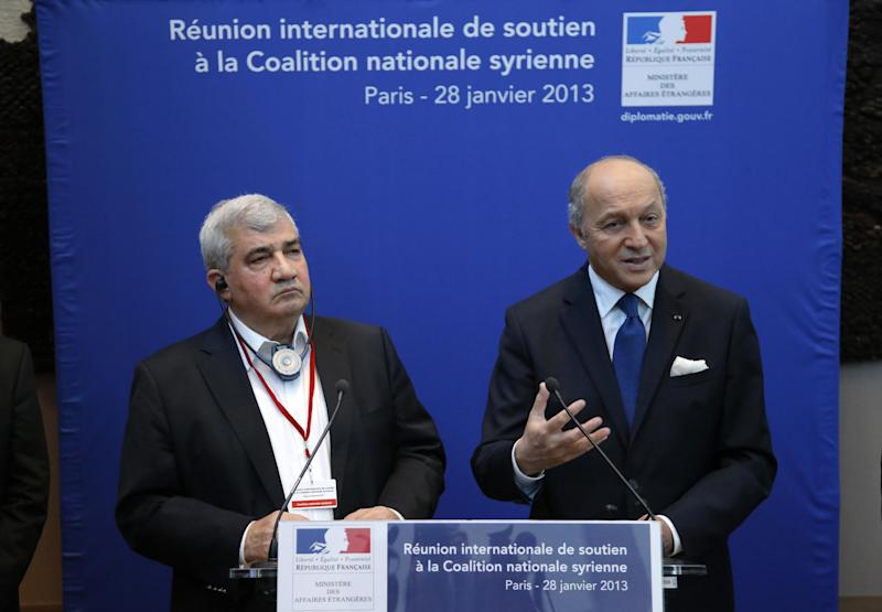 French Foreign Affairs Minister Laurent Fabius, right, flanked by Syrian National Coalition vice-president Riad Seif attend a press conference during the International support meeting of the Syrian National Coalition in Paris, Monday, Jan. 28, 2013. France has called together representatives of some 50 nations to coax them to make good on promises to help the Syrian opposition coalition, in need of funds to move forward in its bid to oust the regime of Bashar Assad. (AP Photo/Francois Mori)