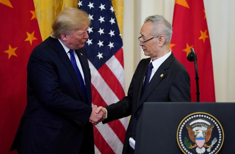 FILE PHOTO: U.S. President Donald Trump shakes hands with Chinese Vice Premier Liu He during U.S.-China trade signing ceremony at the White House in Washington