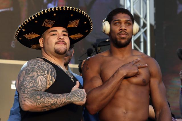 "Heavyweight boxers Anthony Joshua of Britain, right, and Andy Ruiz Jr. of Mexico pose during a weigh-in at Faisaliah Center, in Riyadh, Saudi Arabia, Friday, Dec. 6, 2019. The first ever heavyweight title fight in the Middle East, has been called the ""Clash on the Dunes."" Will take place at the Diriyah Arena on Saturday. (AP Photo/Hassan Ammar)"