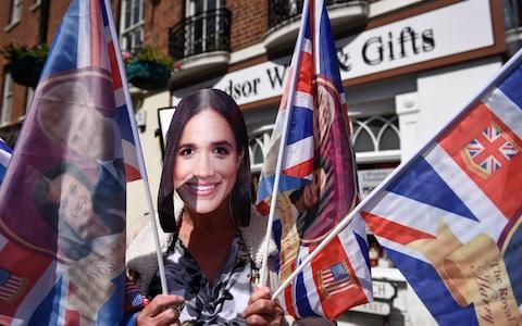 'Meghan Markle' surrounded by flags outside a souvenir shop in Windsor - Credit: Stephen Chung/LNP