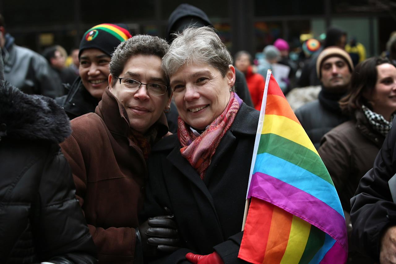 CHICAGO, IL - MARCH 25:  Evette Cardona (L) and her partner Mona Noriega participate in a rally in support of gay marriage March 25, 2013 in Chicago, Illinois. The Supreme Court will hear arguments this week in two cases that could determine if states or the federal government can treat same-sex couples and those of the opposite sex differently when recognizing a marriage. The Illinois Senate has approved legislation that will legalize same-sex marriage in the state but it still has to be approved by the Illinois House and signed by Governor Pat Quinn, who has said he supports the legislation. If passed Illinois would become the tenth state to allow same-sex marriage. Thirty states have defined marriage as a union between a man and a woman.  (Photo by Scott Olson/Getty Images)