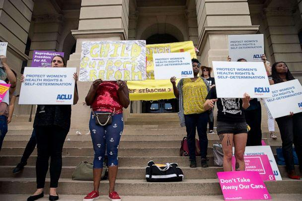 PHOTO: Abortion rights protesters rally outside of the Georgia State Capitol building following the signing of HB 481, in Atlanta, May 7, 2019. (Alyssa Pointer/Atlanta Journal-Constitution via AP)