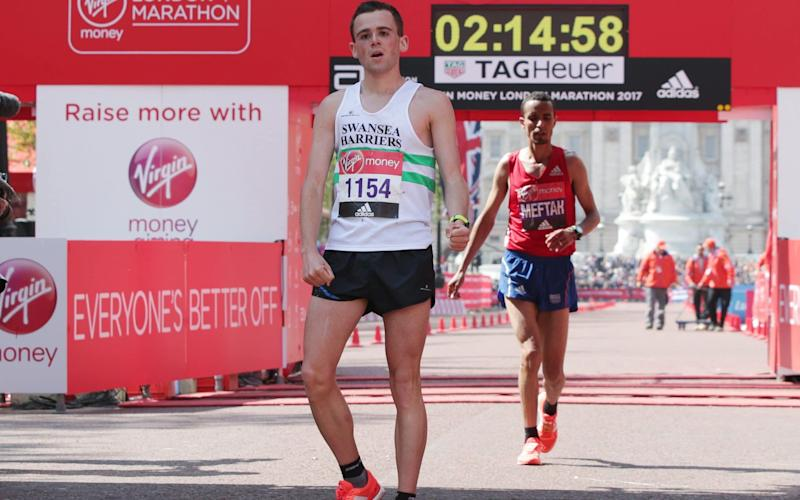 Josh Griffiths finished his debut marathon in 2hr 14min and 49sec to be the first British athlete home - PA