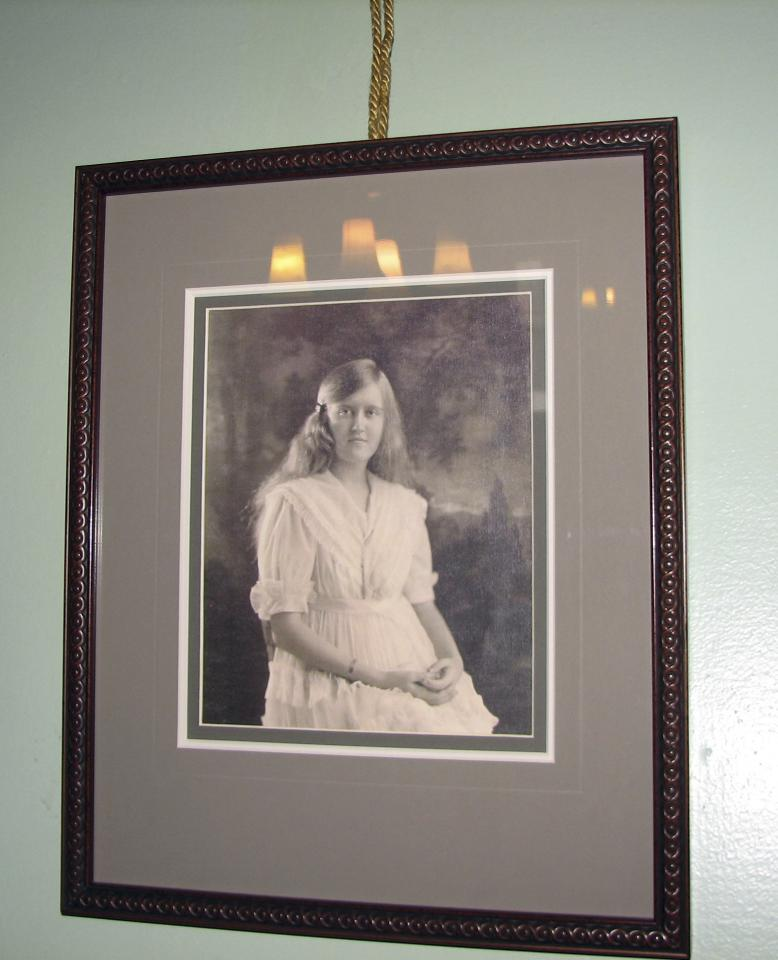 In this Dec. 24, 2011 photo, a portrait of heiress Huguette Clark hangs in one of the bedrooms of the Copper King Mansion in Butte, Mont. The 34-room mansion that W.A. Clark built in Butte more than a century ago is now a bed-and-breakfast and offers visitors a glimpse into the pampered lives of the robber barons who ruled American business at the turn of the previous century. (AP Photo/Nicholas K. Geranios)
