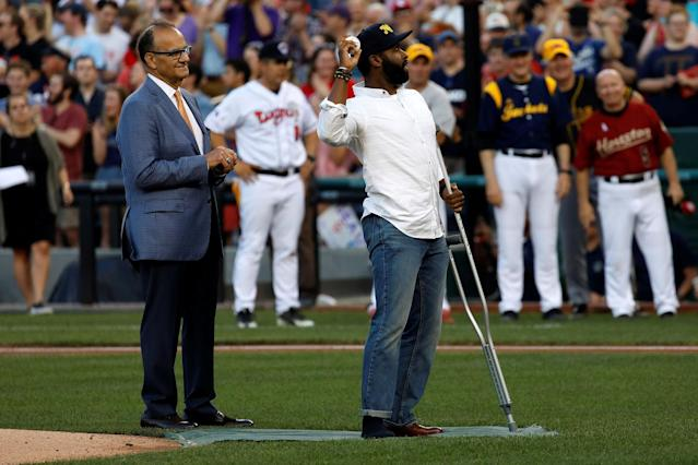 <p>Special Agent David Bailey of the U.S. Capitol Police, wounded in Wednesday's attack, is seen with former Yankees manager Joe Torre, as he throws out the first pitch during the Congressional Baseball Game at Nationals Park in Washington, June 15, 2017. (Photo: Joshua Roberts/Reuters) </p>