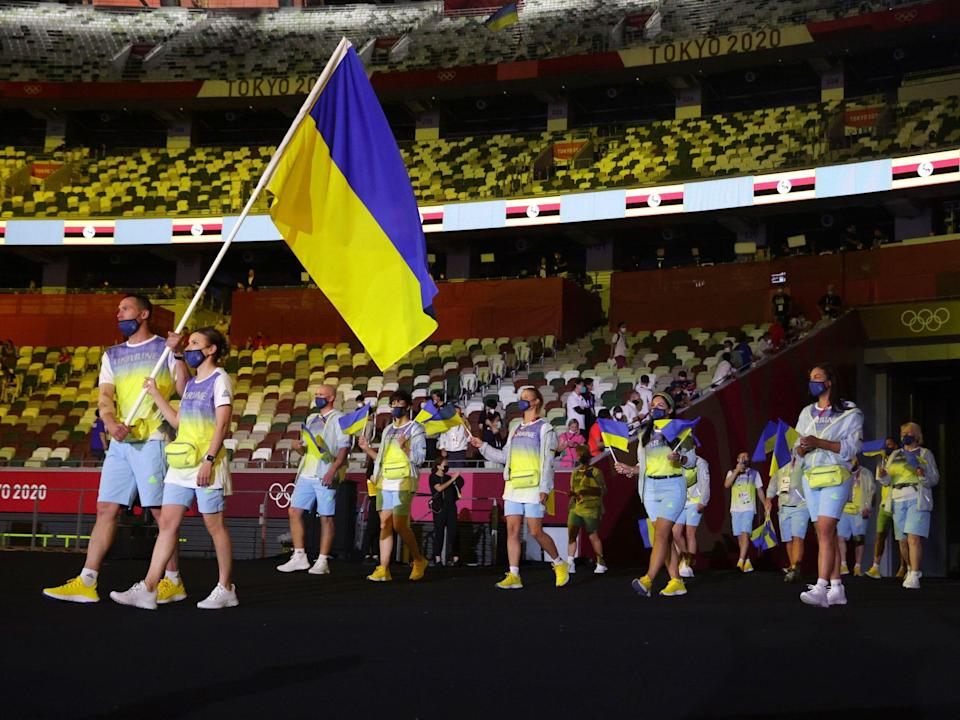 Athletes from Ukraine make their entrance at the Summer Olympics.