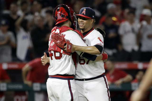 Los Angeles Angels' Hansel Robles, right, and catcher Anthony Bemboom celebrate the team's 6-5 win over the Chicago White Sox in a baseball game Saturday, Aug. 17, 2019, in Anaheim, Calif. (AP Photo/Marcio Jose Sanchez)