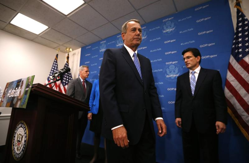 U.S. House Speaker Boehner (R-OH) leaves a news conference following a House Republican party meeting on Capitol Hill in Washington
