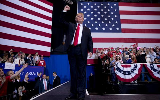 """Donald Trump returned to the campaign trail on Tuesday night with a familiar refrain, criticising Mexico for failing to stop the flow of illegal immigrants to the US and promising to make Mexico pay for his proposed border wall. And the result was the same: Enthusiastic cheers from supporters in Nashville, Tennessee, followed by a swift promise from the Mexican president that no such thing would ever happen. Mr Trump took his message out on the road as part of efforts to shore up Republican votes during what could be tricky mid-term elections in November. Democrats hope an unpopular president could help them wrest back control of the Senate and the House of Representatives. But Mr Trump returned to the talking points that gave him a shock win in 2016. Trump supporters welcome the president as he prepares to speak Credit: Drew Angerer/Getty Images """"I don't want to cause a problem, but in the end, Mexico's gonna pay for the wall ,"""" he said to roars of approval. """"They do absolutely nothing to stop people from going through Mexico, from Honduras and all these other countries... They do nothing to help us."""" Mexico has repeatedly said it has no obligation to help the US build a wall, and Mr Trump has in the past backed away from the pledge only to return to it. Again on Tuesday Enrique Pena Nieto, the Mexican President, insisted that his country would never pay for its construction. President @realDonaldTrump: NO. Mexico will NEVER pay for a wall. Not now, not ever. Sincerely, Mexico (all of us).— Enrique Peña Nieto (@EPN) May 30, 2018 Otherwise, Mr Trump used the rally to fire up his base by celebrating his achievements in office, from a slew of positive economic indicators to making good on his promise to move the US embassy in Israel to Jerusalem. He appealed for Republican unity and said the elections need not mean the party that holds the White House loses congressional seats. """"In November, we will reverse a trend,"""" he said. At a glance 