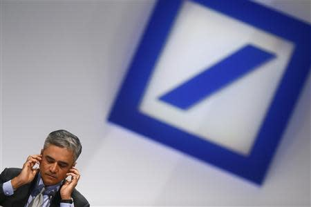 Jain, Co-chief Executive of Deutsche Bank adjusts his headphones during a shareholders meeting in Frankfurt, file