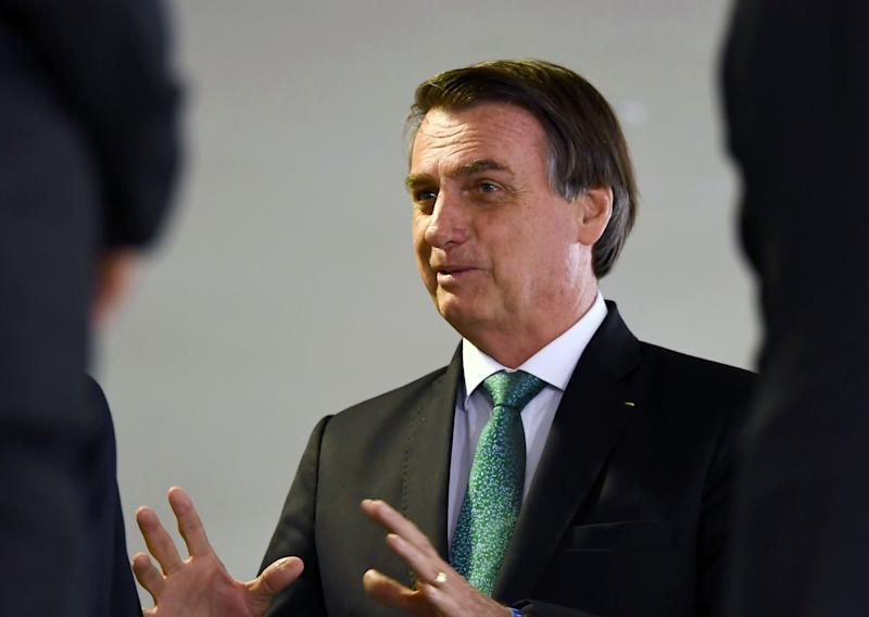 Brazilian President Jair Bolsonaro gestures during a ceremony to announce measures to stimulate the economy at Planalto Palace in Brasilia, on July 24, 2019. - According to the government, the measures will be in force in September and they are planned to inject 42 billion reals (around 11 billion dollars) in the economy by 2020. (Photo by EVARISTO SA / AFP) (Photo credit should read EVARISTO SA/AFP/Getty Images)