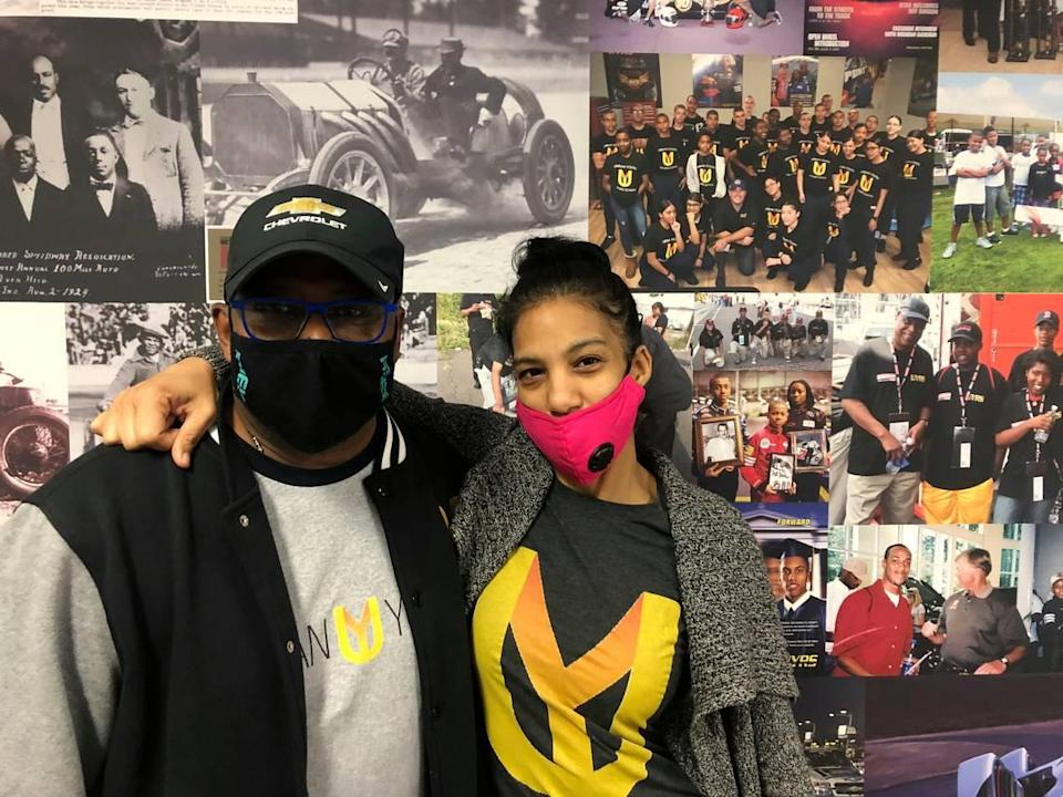Urban Youth Racing School founder Anthony Martin, left, and his wife Michelle Martin pose for a photo at the school, Friday, Oct. 30, 2020, in Philadelphia. The school has made it its mission to introduce inner-city youngsters, most of them black, to the motorsports world. (AP Photo/Dan Gelston)