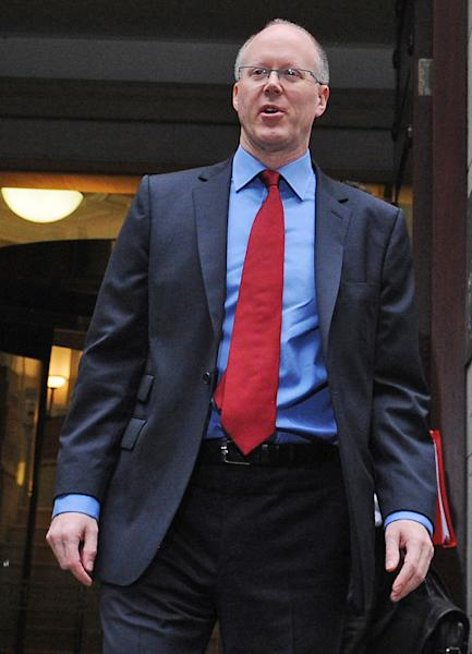 BBC Director General George Entwistle leaves the BBC's Millbank Studios in Westminster, London Tuesday Oct. 23, 2012. The director general of the BBC is set to face a lawmaker committee to explain why the broadcaster pulled an expose unmasking one of its most popular entertainers as a pedophile. George Entwistle will face lawmakers on the Culture Media and Sport Select Committee on Tuesday. The appearance comes a day after BBC reporters put their own bosses in the hot seat over their role in the expanding pedophilia scandal. (AP Photo/Stefan Rousseau/PA Wire) UNITED KINGDOM OUT
