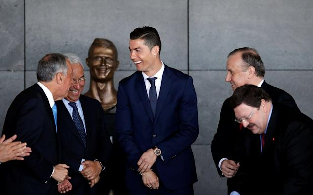 <span>Ronaldo looked in good spirits at the unveiling, despite his fiendish likeness</span> <span>Credit: RAFAEL MARCHANTE/REUTERS </span>