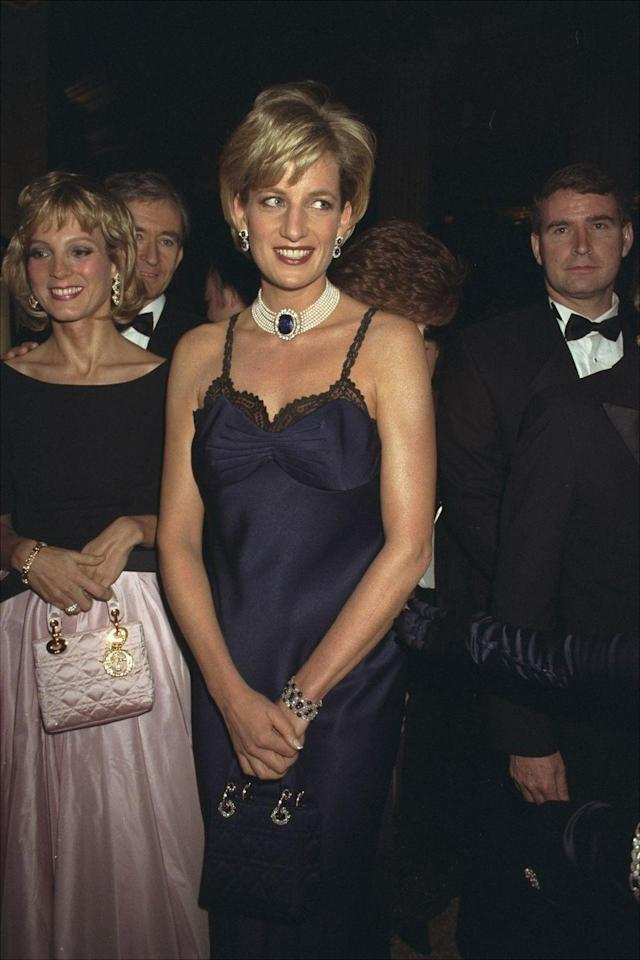 """<p><a href=""""https://www.crfashionbook.com/celebrity/g27194684/princess-diana-through-years-photos/"""" rel=""""nofollow noopener"""" target=""""_blank"""" data-ylk=""""slk:Princess Di"""" class=""""link rapid-noclick-resp"""">Princess Di</a> attended her first and only Met Gala in 1997, just a few months before her tragic death in September 1997. The royal wore a midnight blue slip dress by John Galliano for the house of Dior, along with a sapphire choker and her eponymous <a href=""""https://www.crfashionbook.com/fashion/g26977287/the-women-who-inspired-fashions-most-coveted-handbags/"""" rel=""""nofollow noopener"""" target=""""_blank"""" data-ylk=""""slk:Lady Dior bag"""" class=""""link rapid-noclick-resp"""">Lady Dior bag</a> to finish everything off. The boudoir-ready slip dress was controversial for a royal to wear at the time, but of course, the princess pulled it off with ease.</p>"""