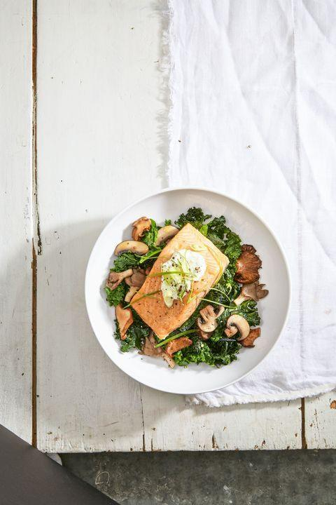 """<p>Broiling salmon in the oven cuts cooking time down to just eight minutes. <strong>Budget tip</strong>: A family-sized fillet packet at your local fishmonger should save you from paying the packing upcharge on individual pieces.</p><p><em><a href=""""https://www.goodhousekeeping.com/food-recipes/easy/a36252/salmon-with-skyr-and-sauteed-kale/"""" rel=""""nofollow noopener"""" target=""""_blank"""" data-ylk=""""slk:Get the recipe for Salmon With Skyr and Sauteed Kale »"""" class=""""link rapid-noclick-resp"""">Get the recipe for Salmon With Skyr and Sauteed Kale »</a></em><br></p>"""