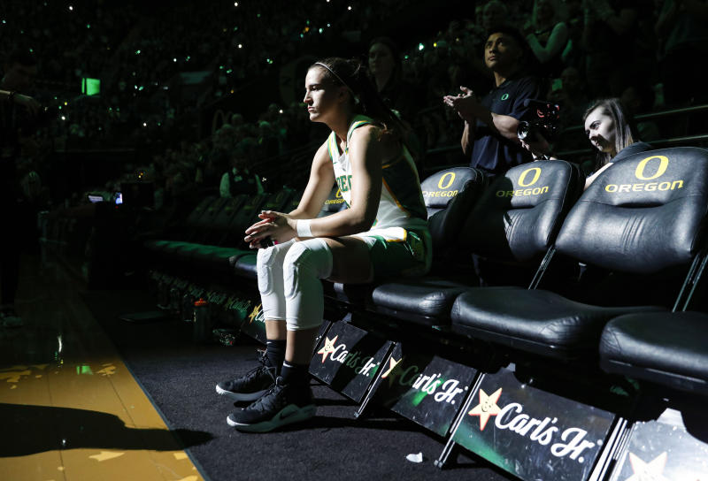 Oregon guard Sabrina Ionescu waits to be introduced before playing Washington in an NCAA college basketball game in Eugene, Ore., Sunday, March 1, 2020. (AP Photo/Thomas Boyd)