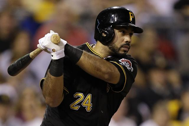 Pittsburgh Pirates' Pedro Alvarez singles off Chicago Cubs starting pitcher Chris Rusin (18), driving in a run, during the fourth inning of a baseball game in Pittsburgh, Thursday, Sept. 12, 2013. (AP Photo/Gene J. Puskar)