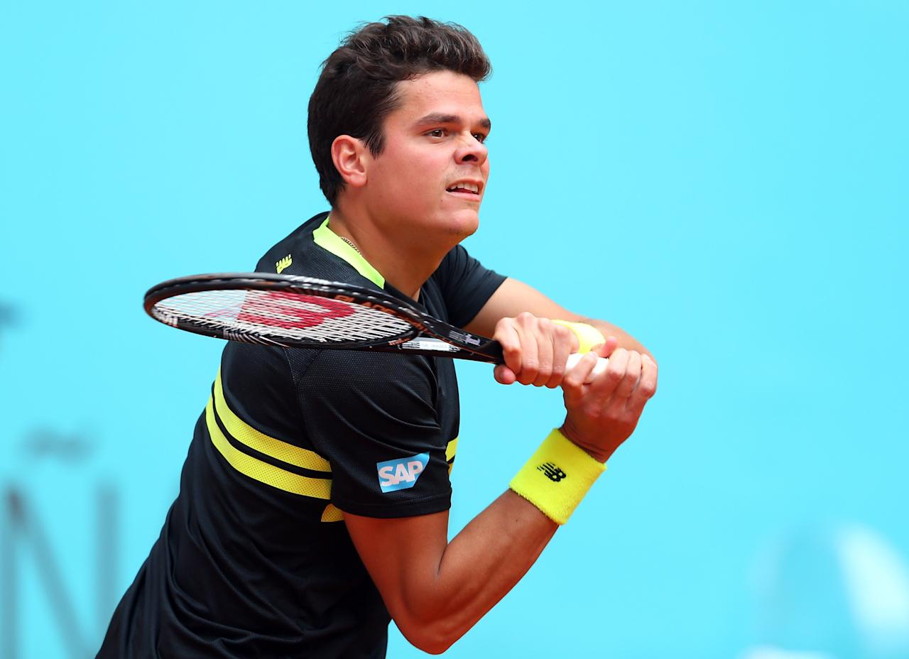 MADRID, SPAIN - MAY 07:  Milos Raonic of Canada in action against Fernando Verdasco of Spain during day four of the Mutua Madrid Open tennis tournament at the Caja Magica on May 7, 2013 in Madrid, Spain.  (Photo by Julian Finney/Getty Images)